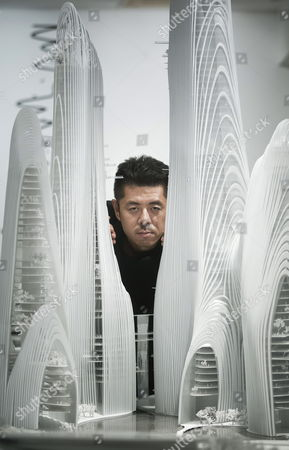 Chinese Architect Ma Yansong Poses in Front of a Scale Model of His Design For the Chinese City of Shanshui at the Exhibition 'Ma Yansong Between (global) Modernity and (local) Tradition' at the Ico Foundation Headquarters in Madrid Central Spain 30 October 2012 the Exhibition Runs From 31 October 2012 to 03 March 2013 Spain Madrid
