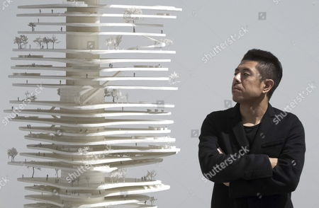 Stock Photo of Chinese Architect Ma Yansong Poses in Front of a Scale Model of His Design 'Urban Forest' For the Chinese City of Chongqing at the Exhibition 'Ma Yansong Between (global) Modernity and (local) Tradition' at the Ico Foundation Headquarters in Madrid Central Spain 30 October 2012 the Exhibition Runs From 31 October 2012 to 03 March 2013 Spain Madrid