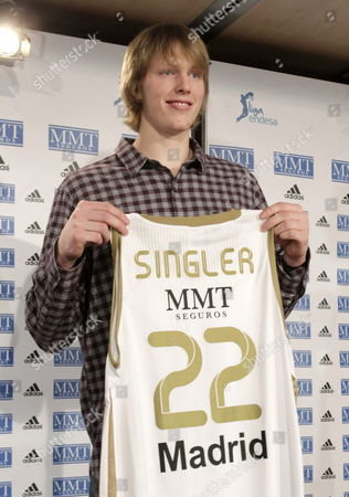 Us Basketball Player Kyle Singler Poses with the Shirt of Real Madrid Basketball Team During His Presentation As New Player For This Season in Madrid Spain on 15 December 2011 Spain Madrid