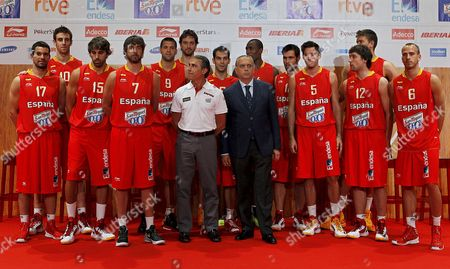 Spanish Basketball Players (l-r) Rafa Martinez Victor Claver Victor Sada Juan Carlos Navarro Felipe Reyes Pau Gasol Head Coach Sergio Scariolo Jose Manuel Calderon Jose Luis Saez (president of the Feb) Serge Ibaka Fernando San Emeterio Rudy Fernandez Sergio Llull Marc Gasol and Sergio Rodriguez Pose For Photographers During the Presentation of the Spanish National Basketball Team For the London 2012 Olympic Games in Madrid Spain 29 June 2012 Spain Madrid