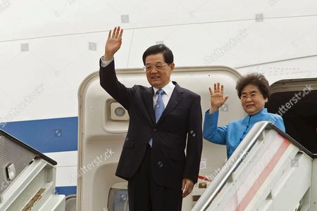 Chinese President Hu Jintao and His Wife Liu Yongqing Wave to Photographers at Their Arrival to the Airport of South Tenerife in Santa Cruz De Tenerife Canary Islands Spain 20 June 2012 For a Technical Stopover of Their Flight From Mexico where They Attended the G20 Summit Jintao was Received by Vice-president of the Spanish Government Soraya Saenz De Santamaria Spain Santa Cruz De Tenerife