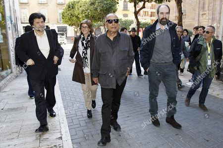 Stock Picture of Spanish Director Victor Erice (l) Iranian Filmmaker Abbas Kiarostami (c) and Spanish Director Jaime Rosales (2-r) Go For a Walk Before Taking Part in a Round Table on the Film Creation Proccess During the 4th Murcia International Film Festival (ibaff) in Murcia Spain 08 March 2013 the Film Festival Runs Until 09 March Spain Murcia