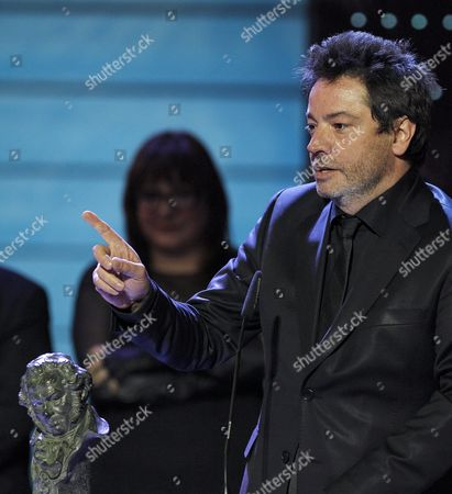Spanish Director Enrique Urbizu Greets Best Director Award For 'No Habra Paz Para Los Malvados' (no Rest For the Wicked) During the Ceremony of the 26th Edition of the Spanish Cinema Goya Awards Held at the Congress City Hall in Madrid Spain 19 February 2012 Spain Madrid