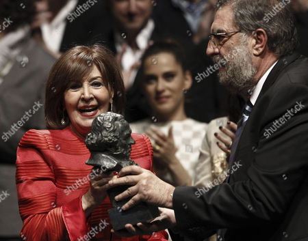 Spanish Film Academy's President Enrique Gonzalez Macho (r) Hands Over the Honorary Spanish Film Academy's Goya Award to Spanish Actress Concha Velasco (l) During the Traditional Academy Awards Nominees Gala at Teatros Del Canal Theater in Madrid Spain Late 28 January 2013 the 27th Spanish Academy's Goya Awards Ceremony Will Be Held on 17 February 2013 in Madrid Spain Madrid