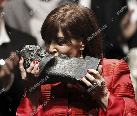 Spanish Actress Concha Velasco Kisses Her Honorary Spanish Film Academy's Goya Award After She Had Received It From Spanish Film Academy's President Enrique Gonzalez Macho (unseen) During the Traditional Academy Awards Nominees Gala at Teatros Del Canal Theater in Madrid Spain Late 28 January 2013 the 27th Spanish Academy's Goya Awards Ceremony Will Be Held on 17 February 2013 in Madrid Spain Madrid