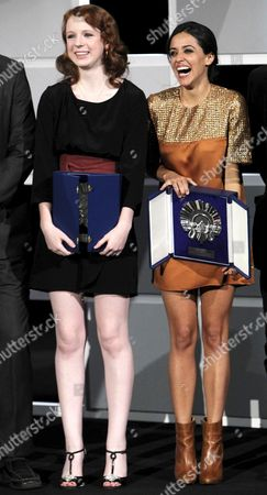 Stock Photo of Spanish Actress Macarena Garcia (r) and Canadian Katie Coseni (l) Pose with the Concha De Plata Trophy For the Best Actress During the Closing Ceremony of the 60th Edition of San Sebastian International Film Festival in San Sebastian Northern Spain 29 September 2012 Spain San Sebastian