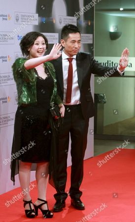 Stock Photo of Chinesse Director Emily Tang (l) and Chinese Actor Taisheng Chen Pose During the Closing Ceremony of the 60th Edition of San Sebastian International Film Festival in San Sebastian Northern Spain 29 September 2012 Spain San Sebastian