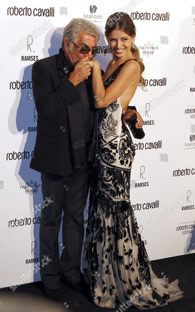 Stock Photo of Italian Designer Roberto Cavalli (l) Poses with Ukrainian Actress Natasha Yarovenko During the Opening of the First Cavalli Store in Madrid Spain 13 September 2012 Spain Madrid