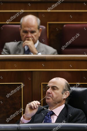 Spain's Economy Minister Luis De Guidos (bottom) and Socialist Member of Parliament Manuel Chaves (up) Attend a Session at the Congreso (spanish Lower House) in Madrid Central Spain on 12 April 2012 De Guindos Defended on 12 April the Amendment of Certain Financial Rules Regarding the Powers of Spain's Financial Supervisory Authorities Spain Madrid