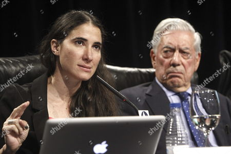 Cuban Blogger and Dissident Yoani Sanchez (l) in the Presence of Literature Nobel Laureate Peruvian Writer Mario Vargas Llosa (r) Delivers Her Speech on the Freedom of the Press in Latin America During the the Closing Ceremony of the 6th Atlantic Forum at Casa De America in Madrid Spain 04 July 2013 Spain Madrid