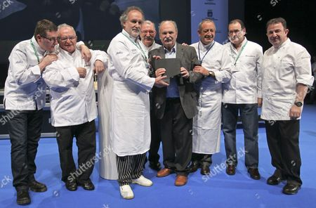 Stock Picture of Spanish Chefs Martin Berasategi (r) Hilario Arbelaitz (2r) Karlos Arguinano (3r) Andoni Luis Aduriz (l) Juan Mari Arzak (2l) Ramon Roteta (3l) and Pedro Subjijana (4l) Pose with Luis Irizar (4r) During a Tribute to Irizar on the Occasion of the 13th San Sebastian Gastronomika Fair Held in San Sebastian Spain 21 November 2011 Continuing in the Direction Established at Last Years Edition of the Convention This Thirteenth Installment of the Event Will Present an Original Diverse Program with a Variety of Formats an Eclectic International Vision and an Extensive Look at the World of Gastronomy Exploring It in All Its Diverse Wealth Spain San Sebastian