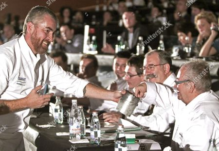 Brazilian Chef Alex Atala (l) Offers One of His Creations to Spanish Chef Juan Mari Arzak (r) During the 13th San Sebastian Gastronomika Fair Held in San Sebastian Spain 21 November 2011 Continuing in the Direction Established at Last Years Edition of the Convention This Thirteenth Instalment of the Event Will Present an Original Diverse Programme with a Variety of Formats an Eclectic International Vision and an Extensive Look at the World of Gastronomy Exploring It in All Its Diverse Wealth Spain San Sebastian