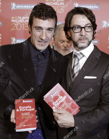 Spanish Chefs Quique Dacosta (r) of Quique Dacosta Restaurant and Eneko Atxa (l) of Azurmendi Restaurant Pose with the Michelin Food Guide 2013 of Spain and Portugal During Its Presentation Act Held in Madrid Spain 22 November 2012 Both Chefs Have Been Awarded in This Edition with Three Michelin's Stars That Added to Another Five Restaurants in Spain with Three Stars Makes Seven Spanish Restaurant with the Highest Distinction by This Guide Spain Madrid