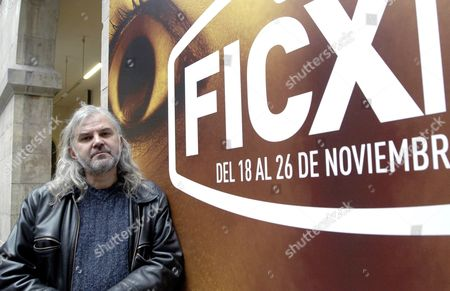 Stock Picture of Austrian Filmmaker Michael Glawogger Poses in Front of a Poster of the Gijon International Film Festival in Gijon Spain 23 November 2011 the Film Festival Honored Glawogger with a Retrospective of His Work and the Screening out of Competition of His Documentary Film 'Whores' Glory' the Film Festival Runs Until 26 November Spain Gijon