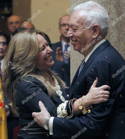 Foreign Minister of the Spanish New Goverment Jose Manuel Garcia-margallo (r) Greets His Predecessor Trinidad Jimenez After Taking Over His Post During the Ceremony at the Palace of Santa Cruz in Madrid Spain 22 December 2011 Spain Madrid