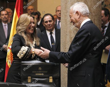 Stock Picture of Foreign Minister of the Spanish New Goverment Jose Manuel Garcia-margallo (r) Greets His Predecessor Trinidad Jimenez After Taking Over His Post During the Ceremony at the Palace of Santa Cruz in Madrid Spain 22 December 2011 Spain Madrid