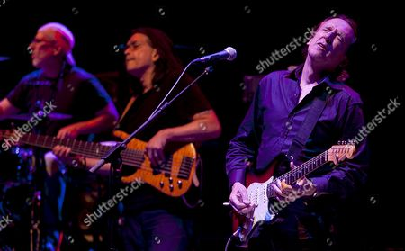 Stock Photo of Us Band 'Renegade Creation' Members (l-r) Gary Novax Jimmy Haslip and Michael Landau Perform on Stage During Their 32th Cordoba´s Guitar Festival Concert at Axerquia Theatre in Cordoba Southern Spain 10 July 2012 Spain Cordoba