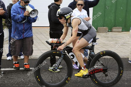 Stock Photo of German Athlete Kristin Moeller Competes in the Cycling Leg of the Women's Lanzarote Ironman at Playa Grande Beach in Puerto Del Carmen Lanzarote the Canary Islands 18 May 2013 Moeller Won the Race Spain Puerto Del Carmen (lanzarote)