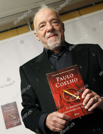 Brazilian Novelist Paulo Coelho Poses For the Media During the Presentation of His Latest Novel 'Manuscript Found in Accra' in Madrid Spain 21 November 2012 Spain Madrid