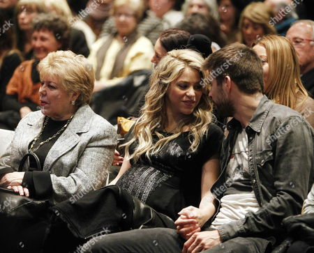 Colombian Singer Shakira (c) Chats with His Boyfriend Fc Barcelona's Player Gerard Pique (r) Next to His Mother Nicia Del Carmen Ripoll Torrado (l) During the Presentation of Her Father's William Mebarak Chadid Book 'Al Viento Y Al Azar (at Wind and at Random)' in Barcelona Northeastern Spain 14 January 2013 Spain Barcelona