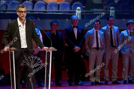 Spanish Film Director Eduard Cortes (l) Delivers As Speech As He Presents His Film 'The Pelayos' During the Opening Gala of the Malaga Film Festival at the Cervantes Theater in Malaga City Southern Spain Late 21 April 2012 the Premiere of Spanish Film 'The Pelayos' Which Tells About the Real Life of the Pelayo Family Whose Patriarch Gonzalo Garcia Pelayo Had Developed a Mathematical Method to Break the Bank Legally in Casinos Worldwide Opened the Eight-day Festival Spain Malaga