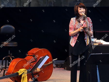 South Korean Singer Youn Sun Nah Performs on Stage During Her Concert Held During the Last Day of the 48th San Sebastian Jazz Festival Basque Country Spain on 28 July 2013 Spain San Sebastián