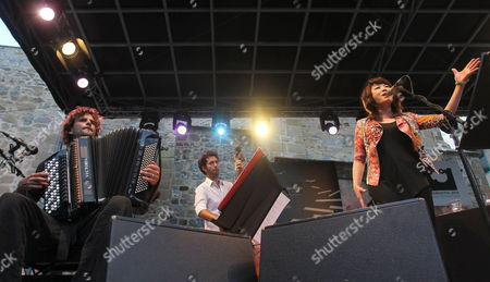 South Korean Singer Youn Sun Nah (l) Performs on Stage with the Members of Her Band Vincent Peirani (l) and Simon Taileu (c) During Her Concert Held During the Last Day of the 48th San Sebastian Jazz Festival Basque Country Spain on 28 July 2013 Spain San Sebastián