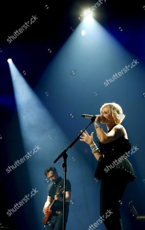 Singer Dolores O' Riordan (r) of Irish Rock Band the Cranberries Performs on Stage During Their Concert in Madrid Central Spain 05 October 2012 Spain Madrid