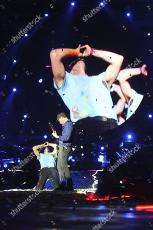 Frontman Chris Martin (l) and Guitarist Jonny Buckland of British Band Coldplay Performs on Stage at Vicente Calderon Stadium in Madrid Spain 20 May 2012 As They Present Their Latest Album 'Mylo Xyloto' Spain Madrid