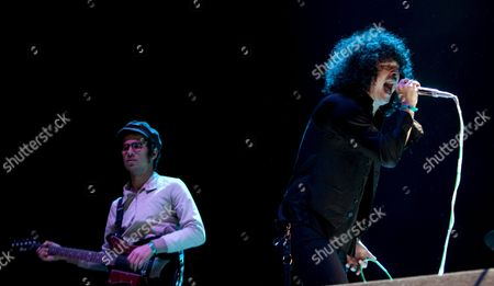 Us Singer Cedric Bixler-zavala (r) and Puerto Rican Guitarist Omar Rodriguez-lopez of Us Progressive Rock Band Mars Volta Perform on Stage at the Azkena Rock Festival in Vitoria Basque Country Northern Spain 15 June 2012 Spain Vitoria