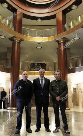 (l-r) Us Musical Director Dennis Russell Davies Director of the Royal Theatre Ignacio Garcia and British Theatre Director Phelim Mcdermott Pose For Photographs During the Presentation of the Opera 'The Perfect American' at the Teatro Real Theatre in Madrid Spain 18 January 2013 the World Premiere of 'The Perfect American' Will Be Held in Madrid on 22 January 2013 Spain Madrid