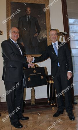 Interior Minister of the Spanish New Goverment Jorge Fernandez Diaz (l) Greets His Predecessor Antonio Camacho (r) After Taking Over His Post During the Ceremony in Madrid Central Spain 22 December 2011 Spain Madrid