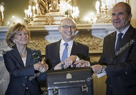 Exchequer and Public Administration Minister of the Spanish New Goverment Cristobal Montoro (c) Poses with the Predecessors Elena Salgado (l) and Manuel Chaves (r) After Taking Over His Post During the Ceremony in Madrid Central Spain on 22 December 2011 Spain Madrid