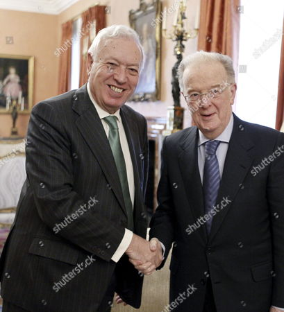Spanish Foreign Minister Jose Manuel Garcia-margallo (l) Shakes Hands with Portuguese Former President and Un High Representative For the Alliance of Civilizations Jorge Sampaio (r) During Their Meeting at Viana Palace in Madrid Spain 11 February 2013 on the Occasion of the First International Seminar on Mediation in the Mediterranean Spain Madrid
