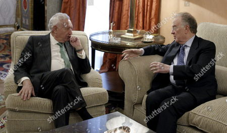 Spanish Foreign Minister Jose Manuel Garcia-margallo (l) Chats with Portuguese Former President and Un High Representative For the Alliance of Civilizations Jorge Sampaio (r) During Their Meeting at Viana Palace in Madrid Spain 11 February 2013 on the Occasion of the First International Seminar on Mediation in the Mediterranean Spain Madrid