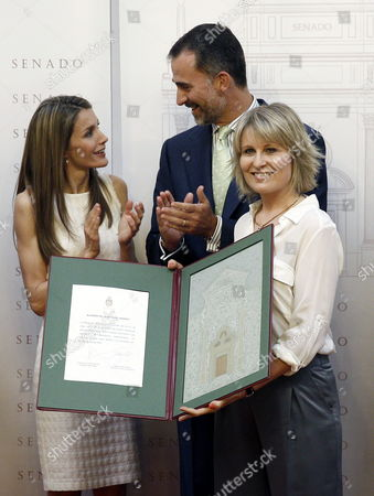 Stock Photo of Spain's Crown Prince Felipe (c) Chats with His Wife Princess Letizia (l) After Presenting the Luis Carandell Parliamentary Journalism Award to Spanish Journalist Maria Rey (r) During a Ceremony Held at the Upper House of the Spanish Parliament in Madrid Spain 24 July 2013 Spain Madrid