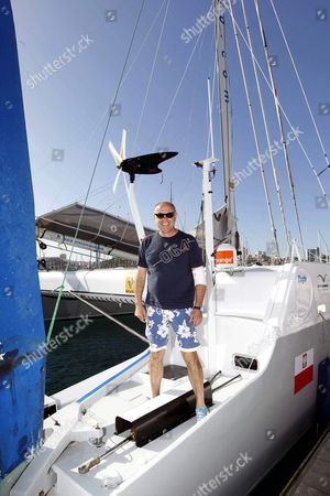 Stock Picture of Polish Sailor Roman Paszke on Board His Catamaran 'Gemini 3' at the Mooring Quay in Las Palmas in Gran Canaria Spain 29 December 2012 Paszke Started His Alone Non-stop Cruise Around the Globe From East to the West From Las Palmas in Gran Canaria 27 December 2012 But Had to Return After His Boat Collided with Unknown Object 110 Miles From Shore Now Captain Paszke Will Have to Wait Three Days Before Knowing if He Will Be Able to Continue His Journey the Polish Captain Will Try to Break the World Record Sailing Around the World in Less Than 122 Days 14 Hours 3 Minutes and 49 Seconds if He Wants to Overcome French Jean Luc Van Den Heede who Currently Holds the Record Spain Las Palmas De Gran Canaria