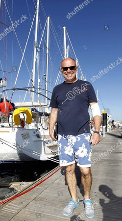 Stock Photo of Polish Sailor Roman Paszke is Seen at the Mooring Quay in Las Palmas in Gran Canaria Spain 29 December 2012 Paszke Started His Alone Non-stop Cruise Around the Globe From East to the West From Las Palmas in Gran Canaria 27 December 2012 But Had to Return After His Boat Collided with Unknown Object 110 Miles From Shore Now Captain Paszke Will Have to Wait Three Days Before Knowing if He Will Be Able to Continue His Journey the Polish Captain Will Try to Break the World Record Sailing Around the World in Less Than 122 Days 14 Hours 3 Minutes and 49 Seconds if He Wants to Overcome French Jean Luc Van Den Heede who Currently Holds the Record Spain Las Palmas De Gran Canaria