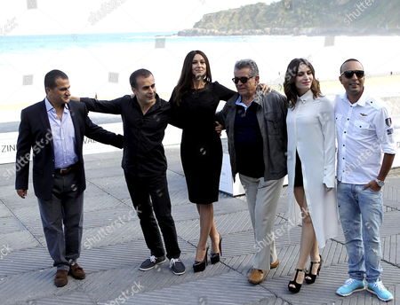 Iranian Filmmaker Bahman Ghobadi (2l) Italian Actress Monica Bellucci (3l) Turkish Actress Belcim Bilgin (2r) Iranian Actors Behrouz Vossoughi (3r) and Arash Labaf (r) and Producer Sabri Ozel Pose For the Media During the Presentation of the Movie 'Rhino Season' at 60th San Sebastian International Film Festival in San Sebastian Northern Spain 27 Septemeber 2012 the Festival Runs From 21 Until 29 September 2012 Spain Madrid