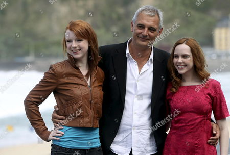 French Filmmaker Laurent Cantet (c) Canadian Actresses Madeleine Bisson (r) and Katie Coseni Arrive to the Presentation of the Film 'Foxfire' at the 60th Edition of San Sebastian International Film Festival in San Sebastian Basque Country Northern Spain 24 Septemeber 2012 Zinemaldia Will Take Place From 21 Until 29 September 2012 Spain San Sebastian