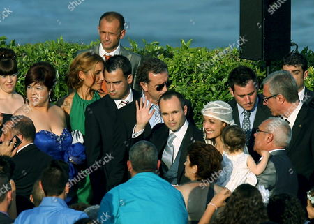 Stock Picture of Fc Barcelona and Spanish National Soccer Team Midfielder Andres Iniesta (c) Waves After Getting Married to Anna Ortiz (3r) After Their Wedding Held at Tamarit Castell Tarragona Catalonia Spain on 8 July 2012 Spain Tamarit