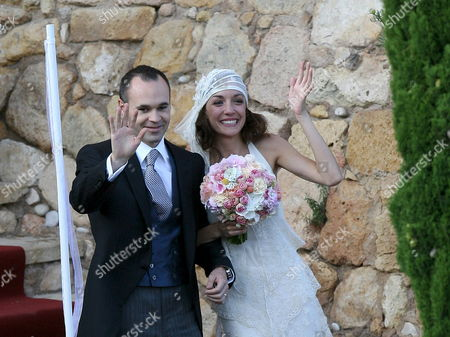 Stock Photo of Fc Barcelona and Spanish National Soccer Team Midfielder Andres Iniesta (l) Waves After Getting Married to Anna Ortiz (r) After Their Wedding Held at Tamarit Castell Tarragona Catalonia Spain 08 July 2012 Spain Tamarit