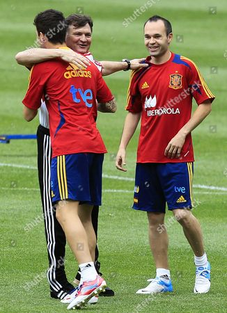 Stock Picture of Chinese National Soccer Team Coach Spanish Jose Antonio Camacho (c) Greets Spanish National Soccer Team Players Cesc Fabregas (l) and Andres Iniesta During a Training Session Held in Seville Spain 02 June 2012 on the Eve of Their Friendly Soccer Match Against China Spain Sevilla
