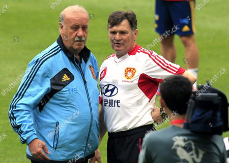 Stock Photo of Chinese National Soccer Team Coach Spaniard Jose Antonio Camacho (r) and Spanish National Soccer Team Coach Vicente Del Bosque During a Training Session Held in Seville Spain 02 June 2012 China Will Face Spain in an International Friendly Soccer Match on June 03 Spain Seville