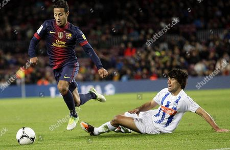 Fc Barcelona's Midfielder Thiago Alcantara (l) in Action Against Manuel Alejandro Garcia (r) of Deportivo Alaves During Their Spanish King's Cup Round of 32 Second Leg Soccer Match at Camp Nou in Barcelona Northeasthern Spain 28 November 2012 Spain Barcelona