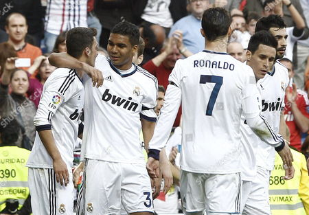 Real Madrid's German Midfielder Mesut Oezil (l) Celebrates with Team-mates Carlos Henrique Casimiro (2-l) Cristiano Ronaldo (7) Callejon and Raul Albiol (r) After Scoring Against Betis During the Spanish Primera Division Soccer Match Between Real Madrid and Real Betis at the Santiago Bernabeu Stadium in Madrid Spain 20 April 2013 Spain Madrid