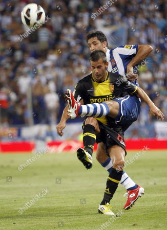 Rcd Espanyol Defender Joan Capdevila (r) Vies For the Ball Against Real Zaragoza's Edu Orioal (l) During Their Spanish Primera Division Soccer Match at Cornella-prat Stadium in Barcelona Catalonia Northeastern Spain 25 August 2012 Spain Cornella