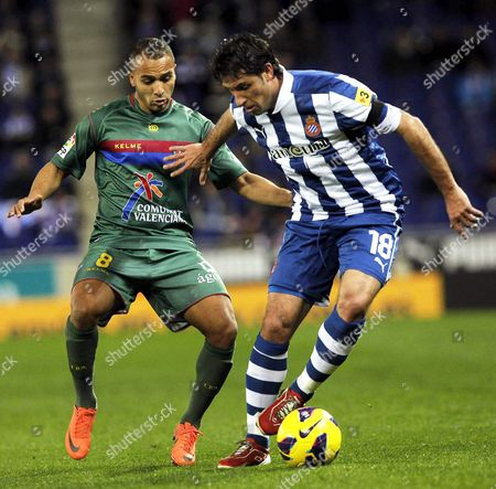 Espanyol's Defender Joan Capdevila (r) in Action Against Moroccan Midfielder Nabil El Zhar (l) of Levante During Their Spanish Primera Division Soccer Match at Cornella-prat Stadium in Barcelona North-eastern Spain 02 February 2013 Spain Barcelona