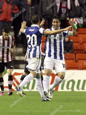 Rcd Espanyol's Players Joan Capdevila (r) and Portuguse Midfielder Simao Pedro Fonseca (l) Jubilate After a Goal Scored by Their Team Mate Mexican Defender Hector Moreno Against Athletic Bilbao During Their Primera Division Soccer Match Played at San Mames Stadium in Bilbao Basque Country Spain on 10 February 2013 Spain Bilbao