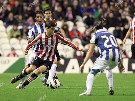 Rcd Espanyol's Defender Joan Capdevila (l) Fights For the Ball with Midfielder Ander Herrera (c) of Athletic Bilbao During Their Primera Division Soccer Match Played at San Mames Stadium in Bilbao Basque Country Spain on 10 February 2013 Spain Bilbao